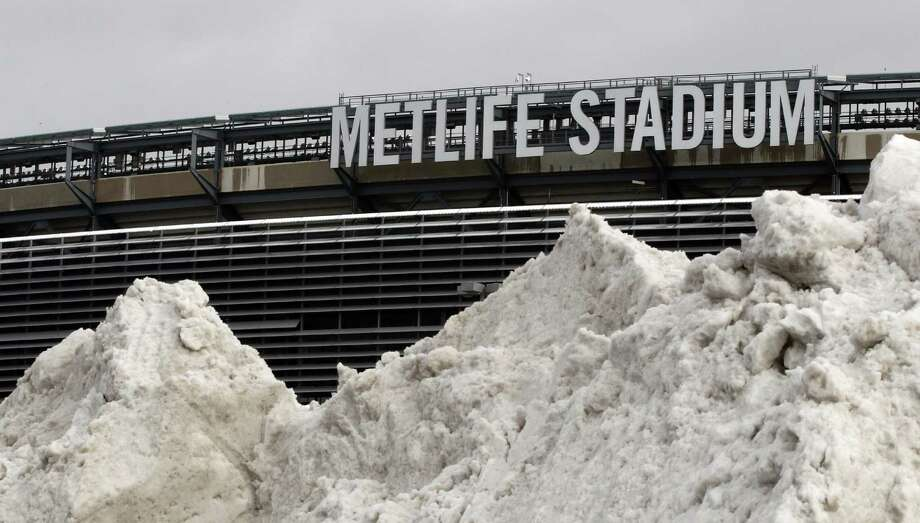 In this Dec. 15, 2013 file photo, a mound of snow is shown outside of MetLife Stadium before an NFL football game between the Seattle Seahawks and the New York Giants, in East Rutherford, N.J. NFL officials may be embracing the notion of a cold-weather Super Bowl, but seriously: What happens if there is, in fact, a snow storm on Feb. 2? (AP Photo/Peter Morgan, File) ORG XMIT: NY164 Photo: Peter Morgan / AP