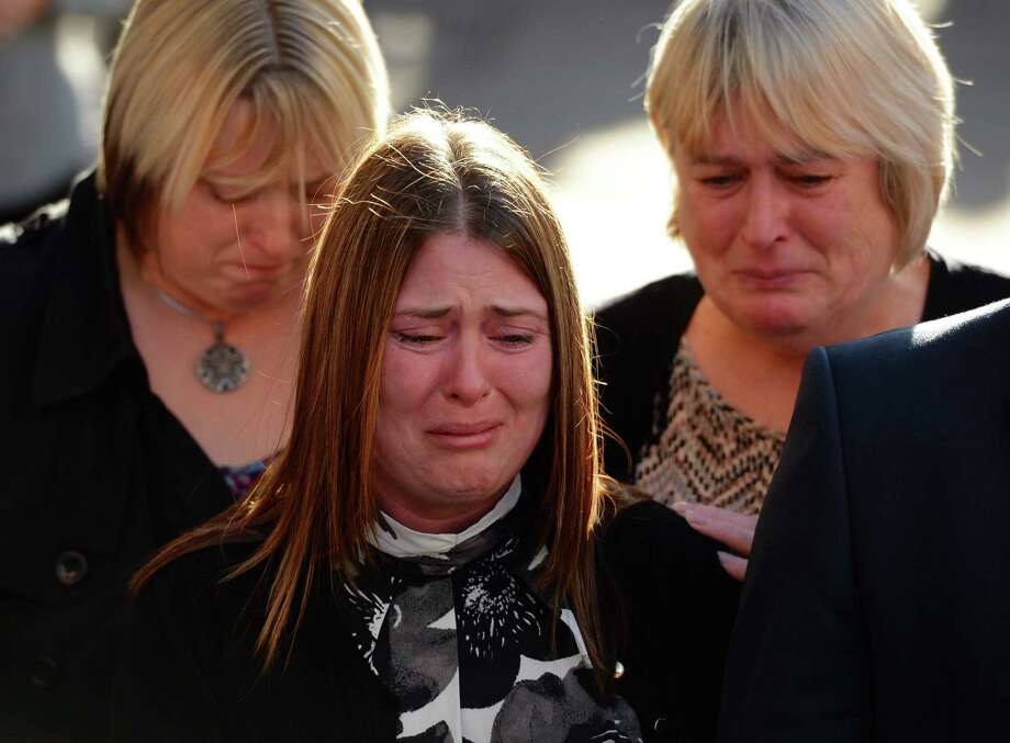 Rebecca Rigby (center), widow of murdered British soldier Lee Rigby, weeps Thursday outside the court in London after the verdict in the trial of two men accused of the murder. Photo: AFP / Getty Images / AFP ImageForum