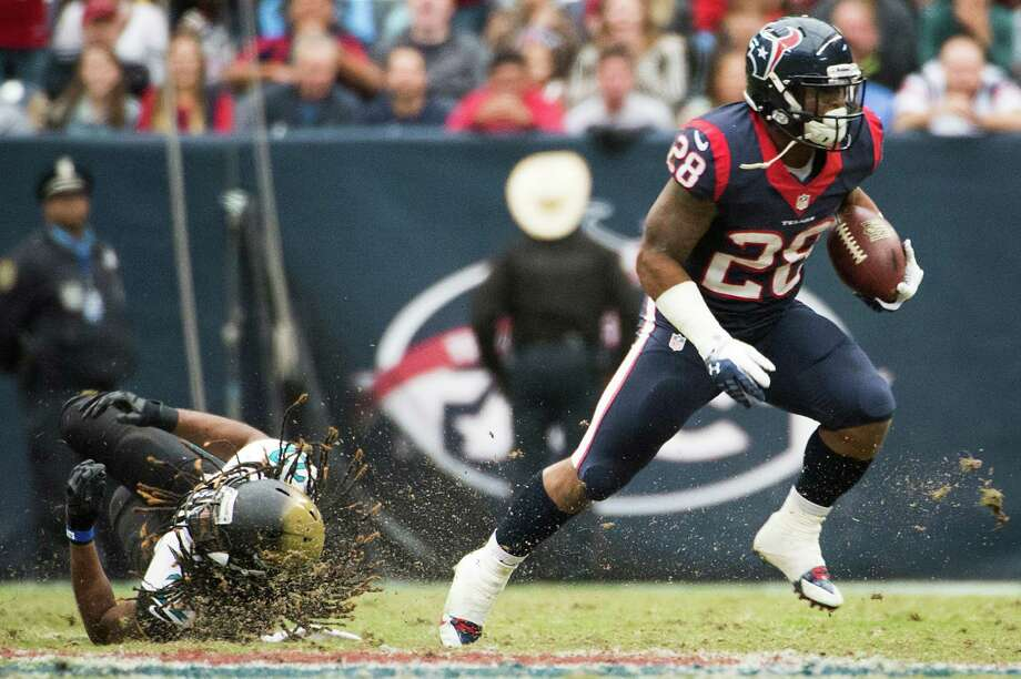 The injury-riddled Texans are glad to have running back Dennis Johnson (28), a rookie free agent who will be making his first NFL start Sunday against Denver. Photo: Smiley N. Pool, Staff / © 2013  Houston Chronicle