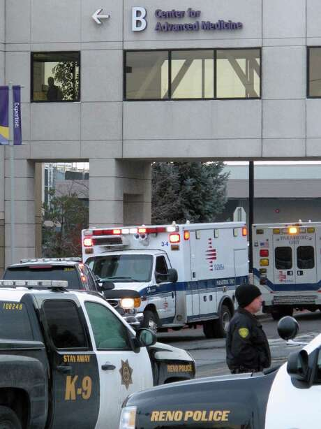 Police close off the streets in front of the Center for Advanced Medicine  in Reno, Nev., after a gunman killed one person and critically wounded two others before turning the gun on himself Tuesday. Photo: Scott Sonner / Associated Press / AP