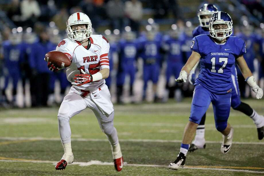 Fairfield Prep's # 15 John DelliSanti hauls in a one handed first down reception against Southington High School during Thursday evening CIAC Class LL football championship game. Southington would win 52-34. Photo: Mike Ross / Mike Ross Connecticut Post freelance - @www.mikerossphoto.com