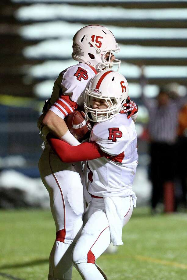 Fairfield Prep's # 15 John DelliSanti get congratulated by teammate #6 Jake Buckley after DelliSanti's first half touchdown during Thursday evening CIAC Class LL football championship game against Southington High School. Southington would win 52-34. Photo: Mike Ross / Mike Ross Connecticut Post freelance - @www.mikerossphoto.com