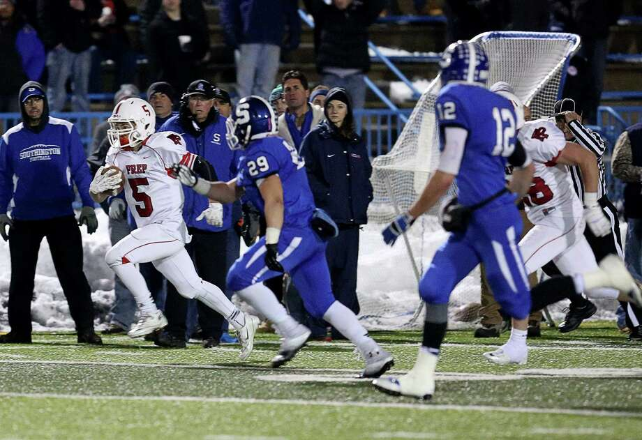 Fairfield Prep's # 5 Brett Stevenson makes his way upfield after Stevenson interception against Southington High School during Thursday evening's CIAC Class LL football championship game. Southington would win 52-34. Photo: Mike Ross / Mike Ross Connecticut Post freelance - @www.mikerossphoto.com