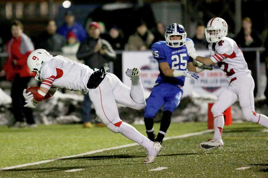 Fairfield Prep's # 9 Anthony Johnson dives into the endzone for a touch down during Thursday evening CIAC Class LL football championship game against Southington High School. Southington would win 52-34. Photo: Mike Ross / Mike Ross Connecticut Post freelance - @www.mikerossphoto.com