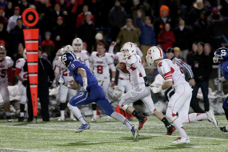 Fairfield Prep's # 10 Henry Purdy rushes for a first down during Thursday evening CIAC Class LL football championship game against Southington High School. Southington would win 52-34. Photo: Mike Ross / Mike Ross Connecticut Post freelance - @www.mikerossphoto.com