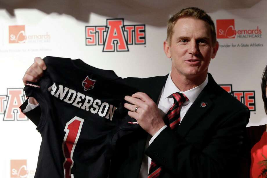 Former North Carolina offensive coordinator Blake Anderson holds an Arkansas State jersey at the school in Jonesboro, Ark., Thursday, Dec. 19, 2013. Anderson was named head football coach at Arkansas State, Thursday. (AP Photo/Danny Johnston) Photo: Danny Johnston, STF / AP