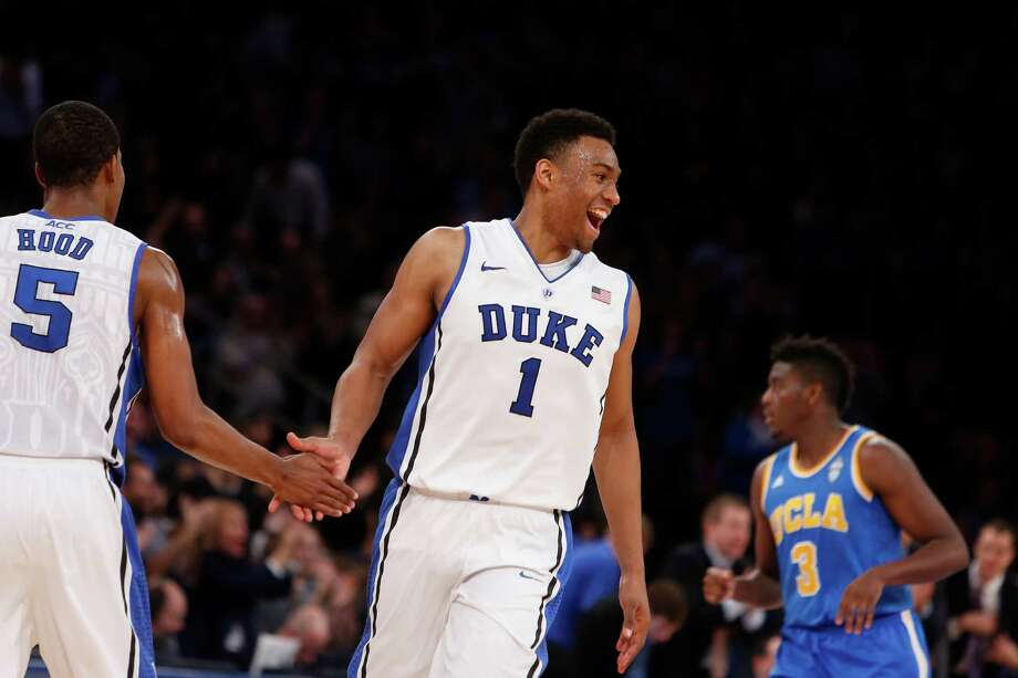 Duke's Jabari Parker (1) celebrates with teammate Rodney Hood (5) during the second half of an NCAA college basketball game against UCLA, Thursday, Dec. 19, 2013, in New York. Duke won 80-63. (AP Photo/Jason DeCrow) ORG XMIT: NYJD105 Photo: Jason DeCrow / FR103966 AP