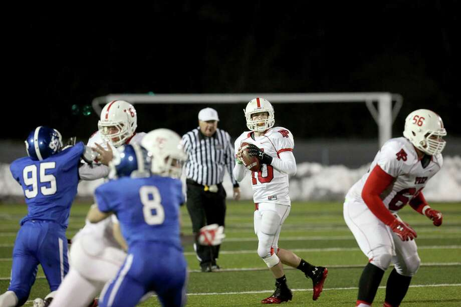 Fairfield Prep's quarterback # 10 Henry Purdy looks for an open receiver during Thursday evening CIAC Class LL football championship game against Southington High School. Southington would win 52-34. Photo: Mike Ross / Mike Ross Connecticut Post freelance - @www.mikerossphoto.com