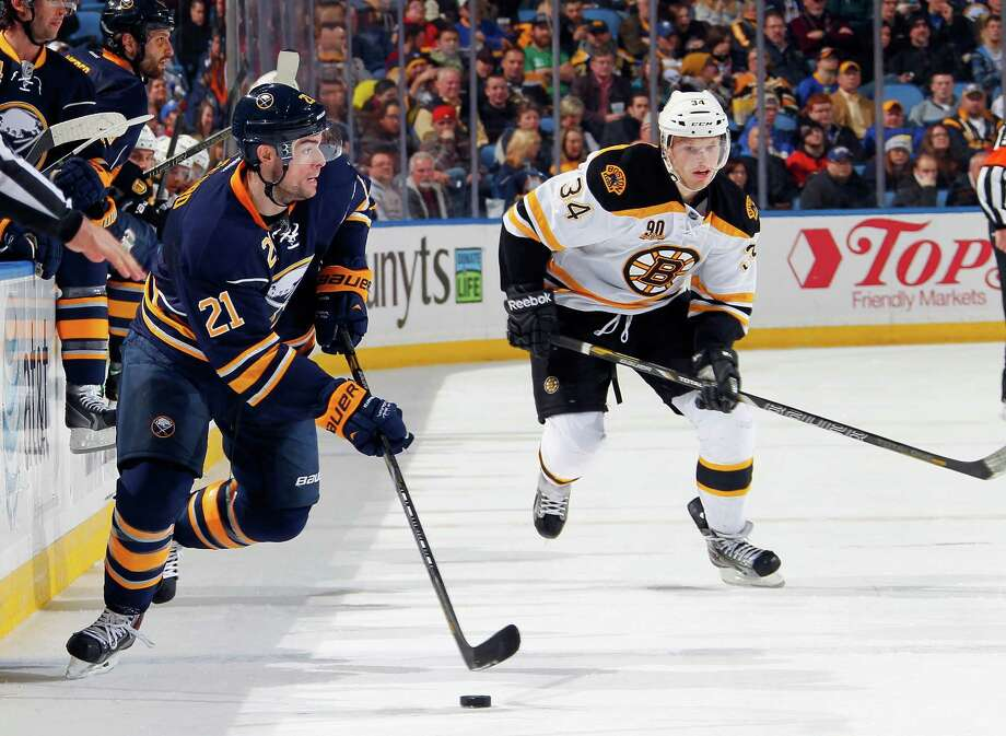 BUFFALO, NY - DECEMBER 19: Drew Stafford #21 of the Buffalo Sabres controls the puck against Carl Soderberg #34 of the Boston Bruins at First Niagara Center on December 19, 2013 in Buffalo, New York.  (Photo by Jen Fuller/Getty Images) ORG XMIT: 181112214 Photo: Jen Fuller / 2013 Getty Images