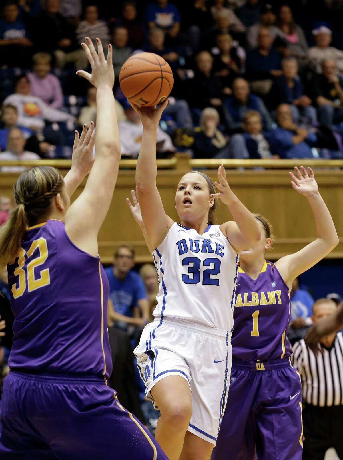 Duke's Tricia Liston (32) shoots as Albany's Megan Craig (32) and Erin Coughlin (1) defend during the first half of an NCAA college basketball game in Durham, N.C., Thursday, Dec. 19, 2013. (AP Photo/Gerry Broome) ORG XMIT: NCGB102