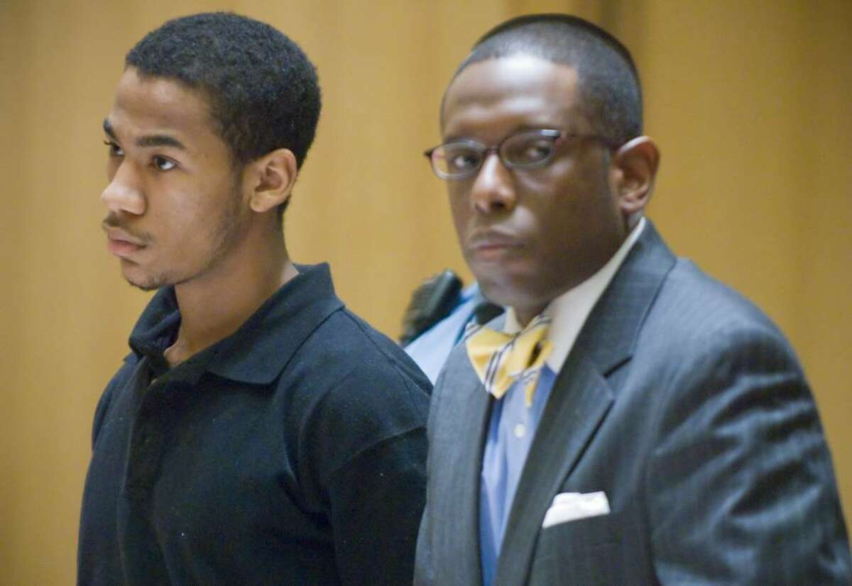 FILE - Hyshon Smith, then 18, left, is arraigned in Superior Court at Stamford for the 2007 murder of Gregory Rowell.