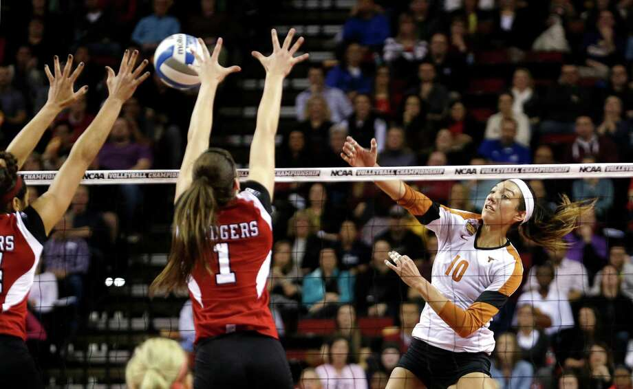 UT's Haley Eckerman, right, finds Wisconsin's defense tough to penetrate in the NCAA semis. She led the Longhorns with 17 kills but also had nine hitting errors. Photo: Elaine Thompson, STF / AP