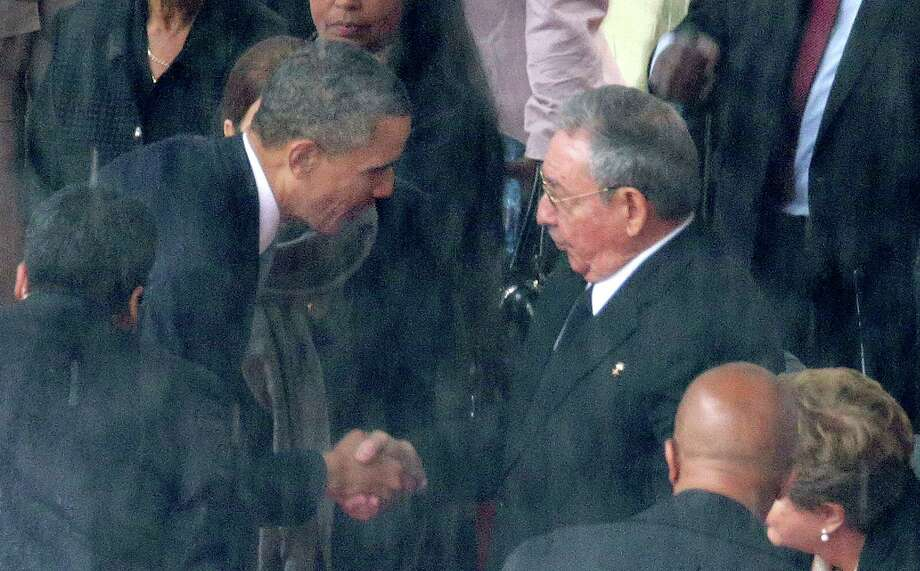 Both U.S. and Cuban officials rejected the notion that the Barack Obama-Raul Castro handshake was anything more than a courtesy. Photo: Chip Somodevilla, Getty Images / 2013 Getty Images
