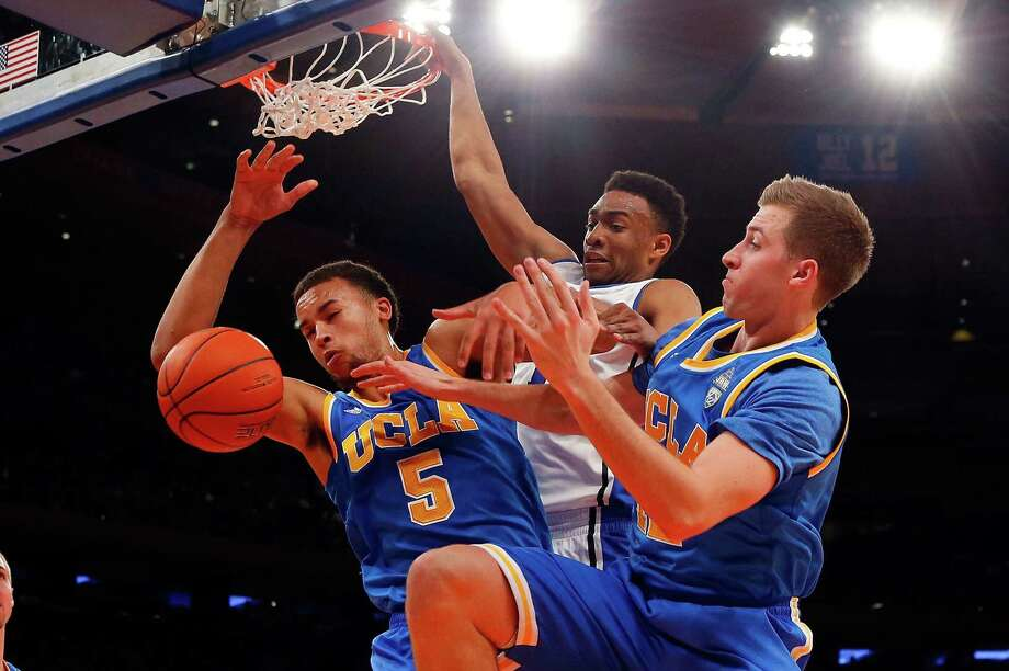 Duke's Jabari Parker (center) battles UCLA's Kyle Anderson (left) and David Wear for a rebound. Photo: Jim McIsaac / Getty Images / 2013 Getty Images