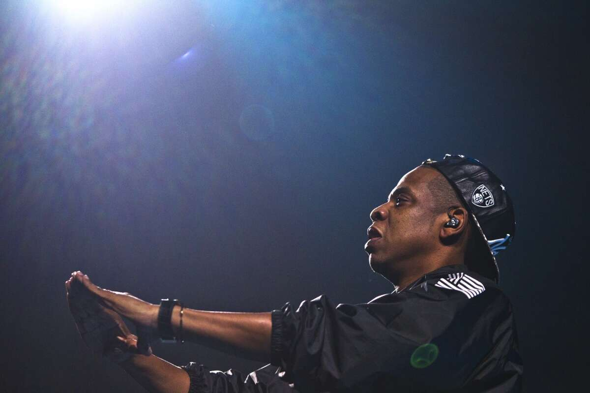 """Jay-Z performs at a packed Toyota Center as his Magna Carta World Tour stops in Houston on Dec. 19. He's promoting his hit album """"Magna Carta Holy Grail."""""""