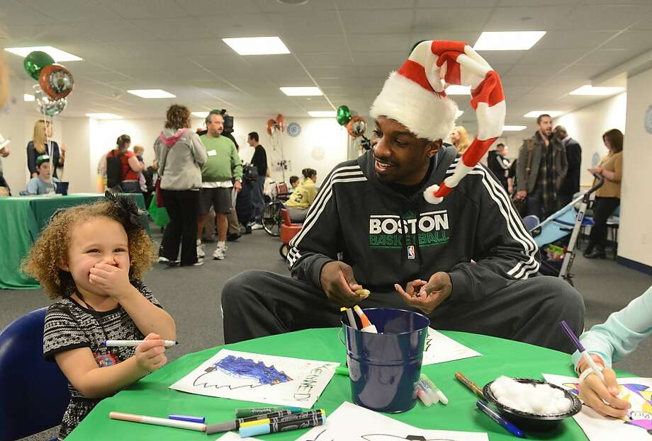 BOSTON, MA - DECEMBER 19: Boston Celtics' Jeff Green colors with Kennedy at Boston Children's Hospital on December 19, 2013 in Boston, Massachusetts. (Photo by Darren McCollester/Getty Images for BCH) Photo: Darren McCollester, Getty Images For BCH