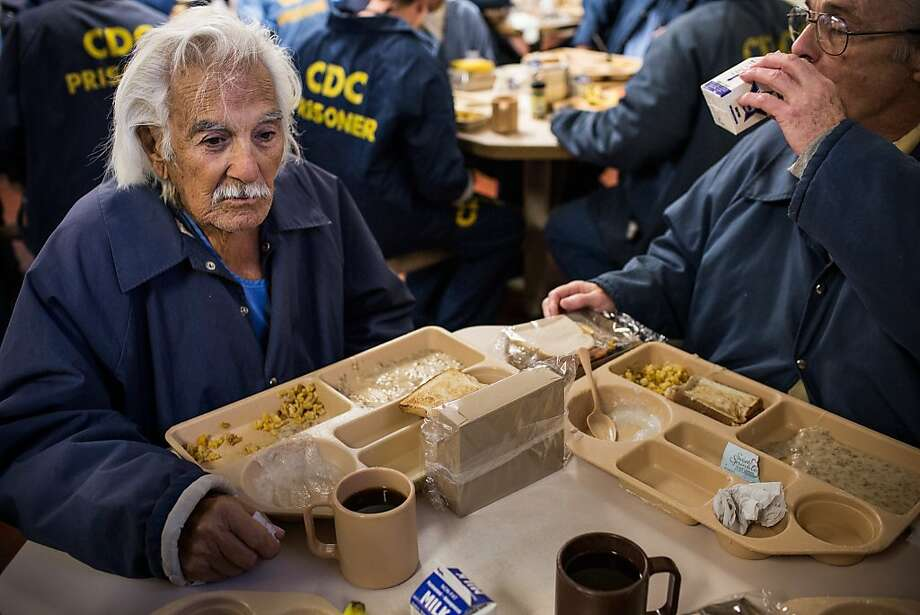 "SAN LUIS OBISPO, CA - DECEMBER 19: (Editorial Use Only)  Anthony Alvarez (L), age 82, eats breakfast with Phillip Burdick, a fellow prisoner and member of the Gold Coats program at California Men's Colony prison on December 19, 2013 in San Luis Obispo, California.  The Gold Coats program is a volunteer care program where healthy prisoners volunteer to take care of elderly prisoners who either need general assistance with mobility and every day life or who also struggle with Alzheimer's and dementia. The program, the first of it's kind in the country, has existed for approximately 25 years. According to Alvarez, he has been incarcerated for 42 years due to a series of burglaries, possession of illegal firearms and escapes from county jail. Eventually these convictions led to him getting a life sentence due to three-strike laws. ""I never shot anyone,"" Alvarez said, ""I had the chance but I could never shoot anyone."" Today is Alvarez's first day being assisted by the Gold Coats; he largely needs help with mobility. Alvarez tries to work out for a few minutes every other day. He says he would like to apply for compassionate release, a program where prisoners are released from prison after being found no longer a threat to society, or if a doctor deems that they are within the last six months of their life. Phillip Burdick, age 62, has been volunteering with the Gold Coats for over 18 years - he is the longest serving member of the Gold Coats. Burdick, who says he became a Christian in prison over 30 years ago, has served 37 years on a 7-years-to-life sentence for first degree murder. ""Being a Christian man, I know God has a plan for everything,"" Burdick says. When asked why he joined the Gold Coats he responds, ""I was attracted to helping other less fortunate than myself - I can't imagine doing anything better in prison."" He hopes to work in a similar line of work if he is released.  (Photo by Andrew Burton/Getty Images) Photo: Andrew Burton, Getty Images"