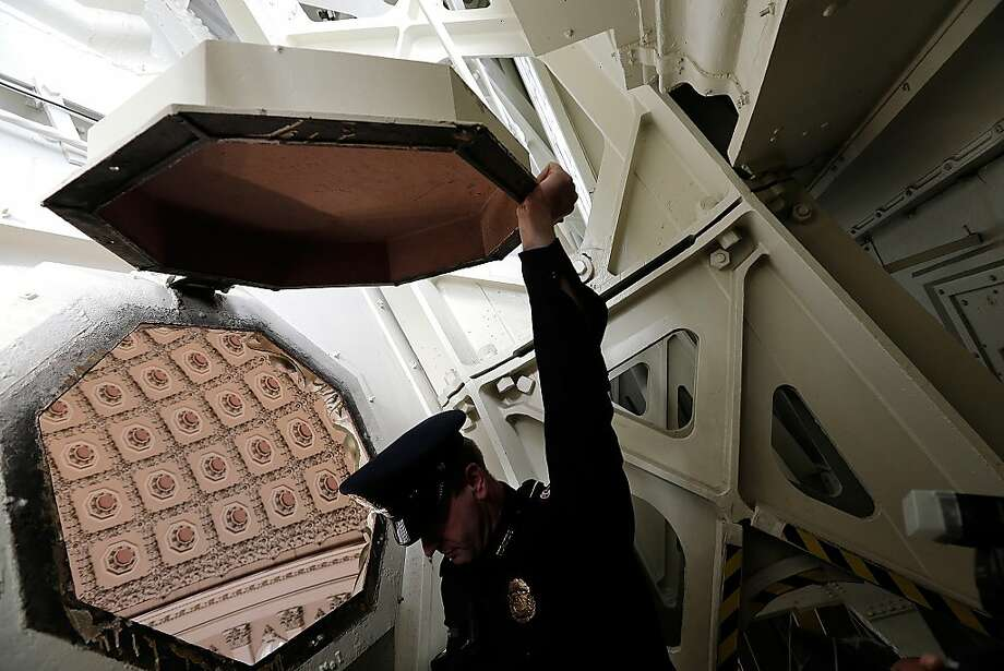 WASHINGTON, DC - DECEMBER 19:  U.S. Capitol Police Officer Adam Taylor holds open one of the coffer windows in the ceiling of the U.S. Capitol dome during a media tour December 19, 2013 in Washington, DC. The dome of the U.S. Capitol will be undergoing a restoration project to halt deterioration in the dome's cast iron as well as ensuring the protection of the interior of the dome and rotunda.  (Photo by Win McNamee/Getty Images) Photo: Win McNamee, Getty Images