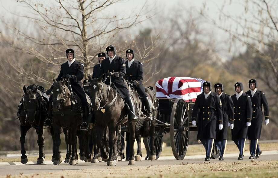 Army honor guard escorts the caisson carrying the remains of U.S. Army Air Corps 1st Lt. Urban L. (Ben) Drew, a flying ace from World War II, during a burial service at Arlington National Cemetery, Thursday, Dec. 19, 2013 in Arlington, Va.   (AP Photo/Manuel Balce Ceneta) Photo: Manuel Balce Ceneta, Associated Press