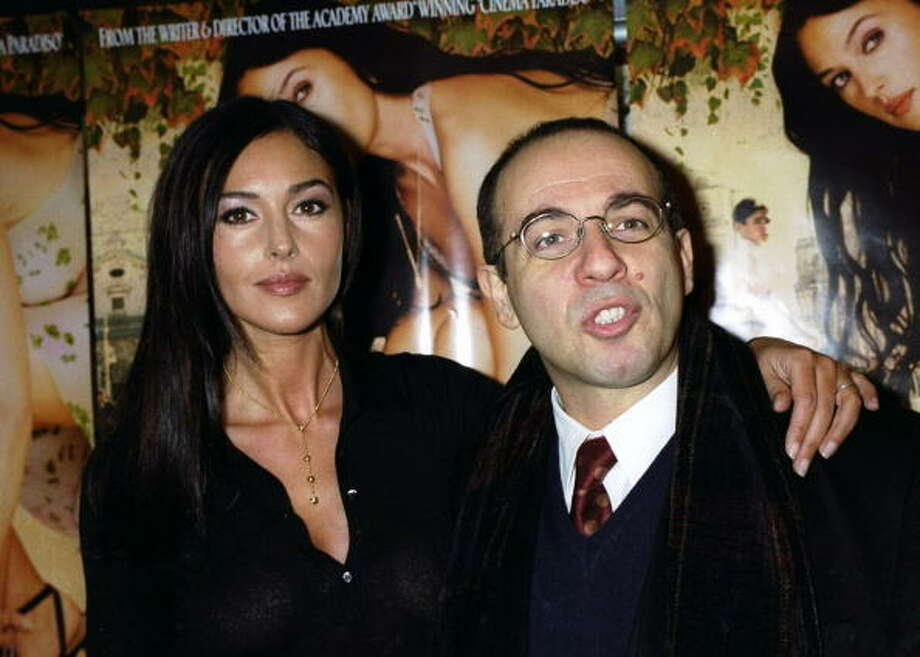 "Monica Bellucci gets together with Giuseppe Tornatore at the premiere of the movie ""Malena"" at the Paris Theater in 2000. She stars in the film, he directed it."