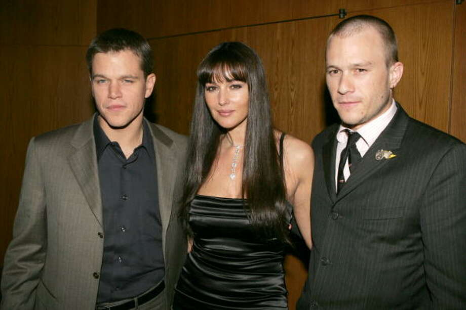 "Actors Matt Damon (left), Monica Bellucci and Heath Ledger pose at the premiere of Dimension Film's ""The Brothers Grimm"" at the Directors Guild Theater in 2005. Photo: Kevin Winter, Getty Images"