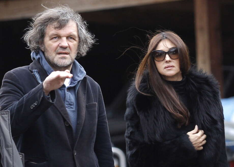 Film director Emir Kusturica (left) and Italian actress Monica Bellucci (right) attend day 3 of the Kustendorf Film Festival in Drvengrad, Serbia in 2013. Photo: Srdjan Stevanovic, WireImage