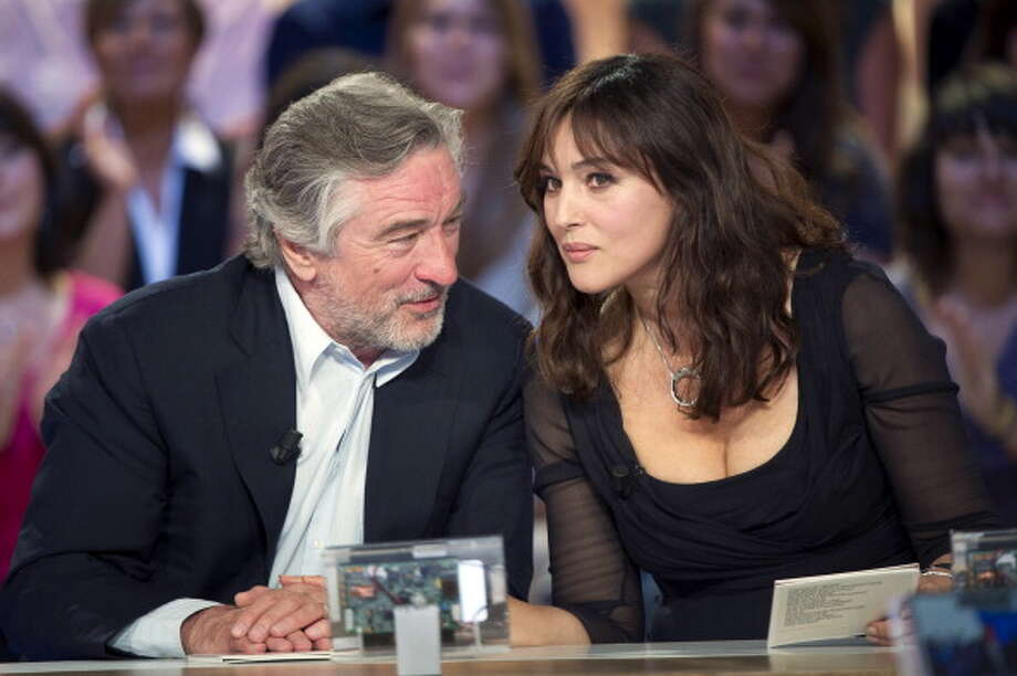 "Italian actress Monica Bellucci and US actor Robert De Niro take part in the TV broadcast show ""Le Grand Journal"" on Canal Plus channel in Paris in 2011. Photo: Bertrand Langlois, AFP/Getty Images"