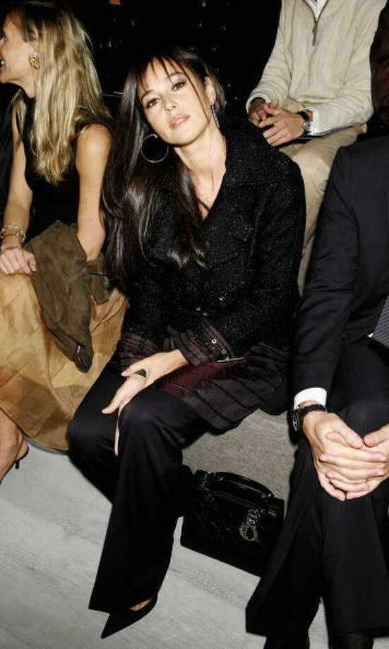 Italian actress Monica Bellucci sits in the audience during the Christian Dior Fashion Show as part of Paris Fashion Week Spring/Summer 2007 in Paris in 2006. Photo: Andrew Lamb/Catwalking, Getty Images / 2006 Catwalking