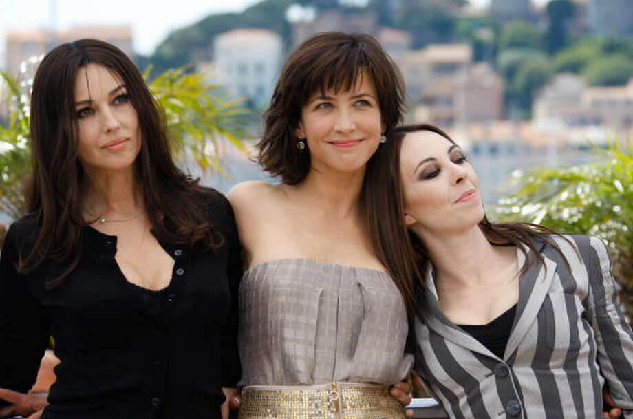 "French actress Sophie Marceau, Italian actress Monica Bellucci (left) and French director Marina De Van (right) pose during the photocall of the movie ""Ne Te Retourne Pas"" (Don't Look Back) out of competition at the 62nd Cannes Film Festival in 2009. Photo: Valery Hache, AFP/Getty Images / 2009 AFP"