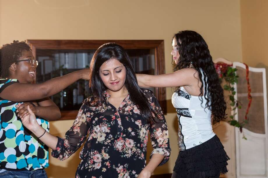 (L-R) Melissa Miller, Ana Garcia, and Summer Sanderson salsa dance at D'Vine Wine's salsa night in Beaumont. Photo: Cat5