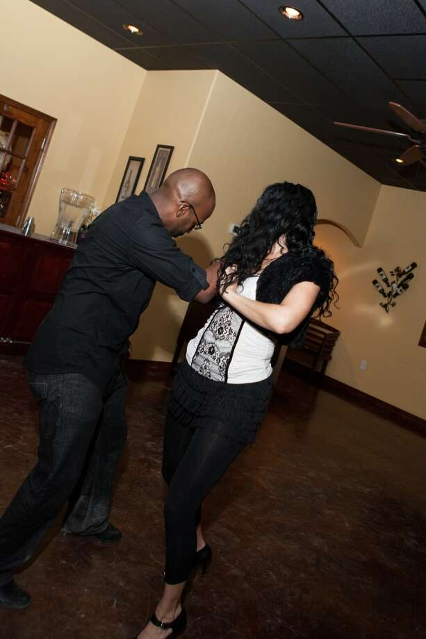 Gordon Scott Williams and Summer Sanderson salsa dance at D'Vine Wine's salsa night in Beaumont on Dec. 6, 2013. Photo: Cat5