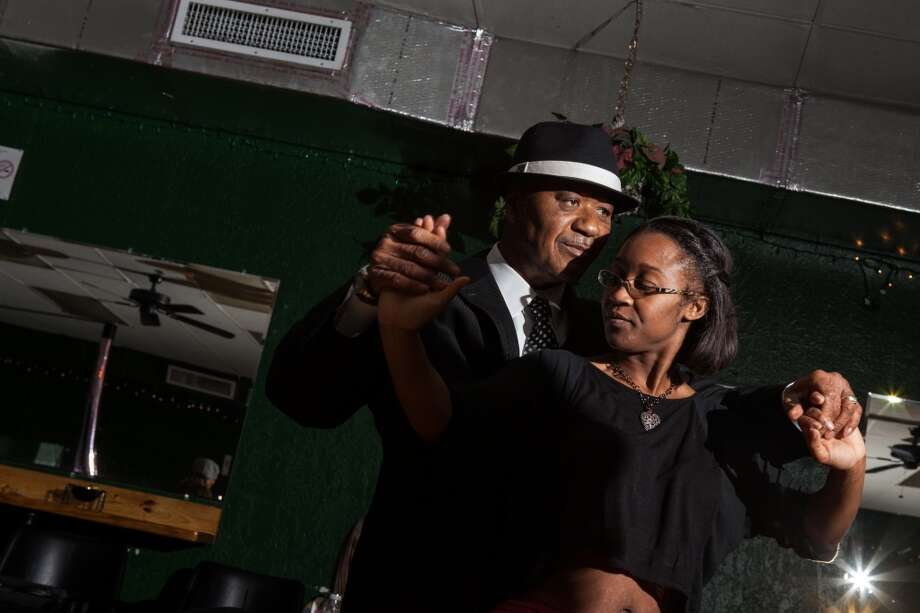 Swing Out Civic Club Vice President Herbert Smith finds a dance partner at the club on Nov. 29, 2013. Photo: Cat5