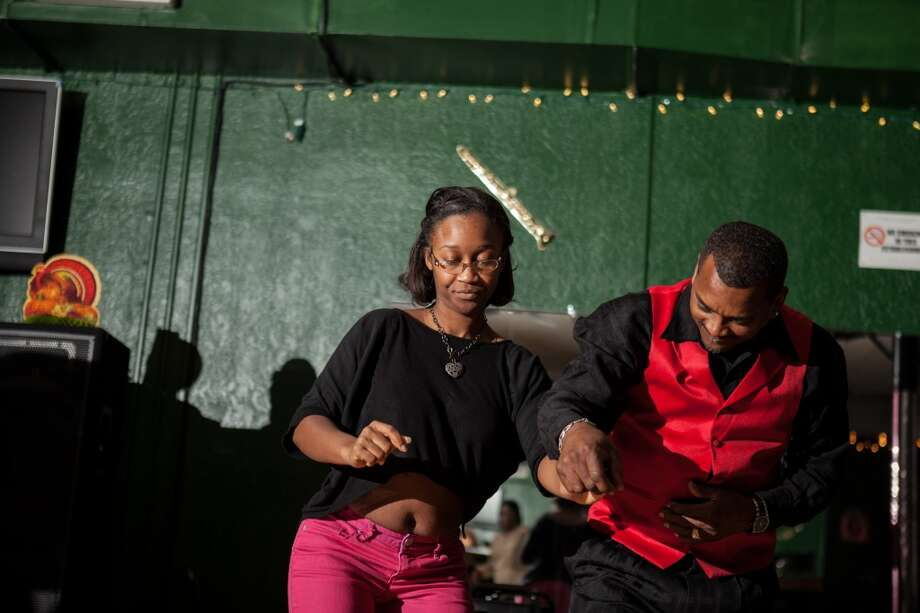 Charles Johnson finds a partner to dance with at the Swing Out Civic Club in Beaumont on Nov. 29, 2013. Photo: Cat5