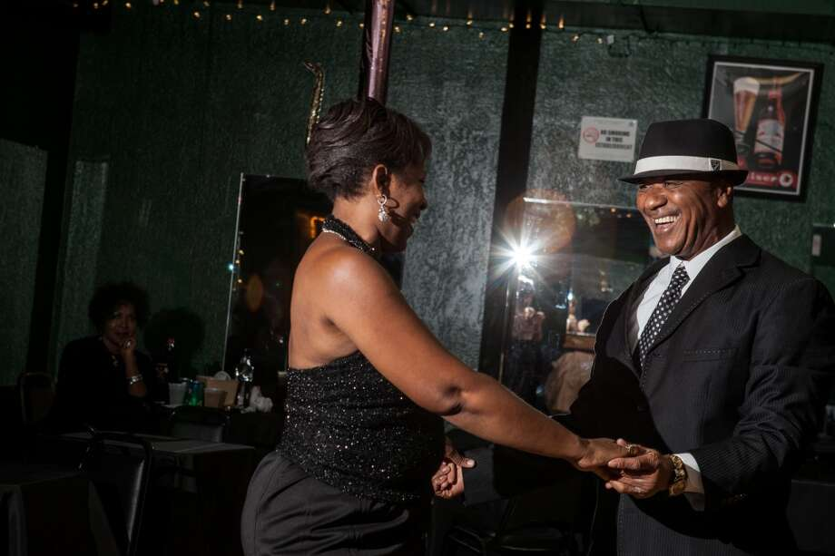 Herbert Smith finds a dance partner to pair up with at Swing Out Civic Club in Beaumont on on Nov. 29, 2013. Photo: Cat5