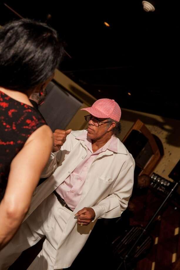 Ronald Vaughn dances at D'Vine Wine's salsa night. Photo: Cat5