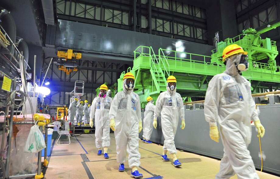 International Atomic Energy Agency (IAEA) experts visit Reactor Unit 4 of the crippled Fukushima Dai-Ichi nuclear power plant to look at the fuel assembly removal process, in Okuma, Japan. Last week, Tokyo Electric Power Co. began moving nuclear fuel assemblies from Reactor Unit 4 to the common spent fuel pool. Photo: Greg Webb, ASSOCIATED PRESS