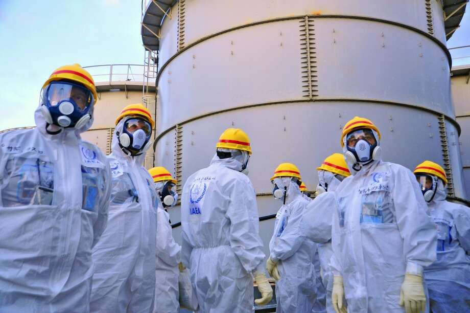 International Atomic Energy Agency experts check out water storage tanks at the crippled Fukushima Dai-ichi nuclear power plant in Okuma, Japan. The expert team is assessing Japanese efforts to decommission the stricken nuclear power plant. Photo: Greg Webb, ASSOCIATED PRESS