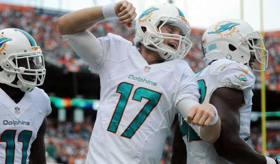 Miami (8-6) minus - 3 at Buffalo (5-9): Dolphins 23-21 Photo: Jim Rassol, McClatchy-Tribune News Service
