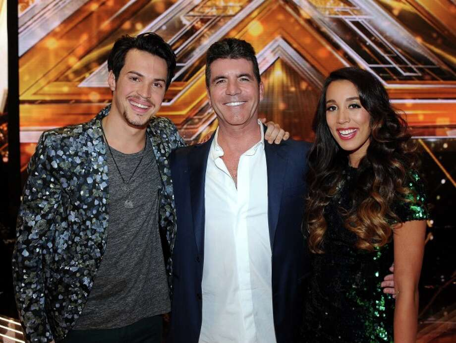 THE X FACTOR: Finale: Simon Cowell and winners of THE X FACTOR Alex & Sierra airing Thursday, Dec. 19 (8:00-10:00 PM ET/PT) on FOX. CR: Ray Mickshaw/ FOX.