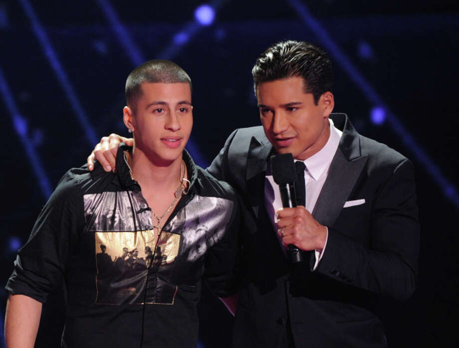 THE X FACTOR: Finale: Carlito Olivero is eliminated on THE X FACTOR airing Thursday, Dec. 19 (8:00-10:00 PM ET/PT) on FOX.  L-R: Carlito Olivero and Mario Lopez. CR: Michael Becker/ FOX.
