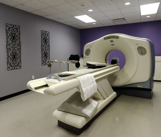 Pictured is the 16-slice CT machine at the Altus Emergency Care Center on Thursday afternoon. The Altus Emergency Care Center on LHS Drive in Lumberton is scheduled to open on Friday morning, and will be the first hospital to operate in Hardin County since the 1990s. The facility will offer emergency medical care 24-hours a day, seven-days a week, and will include rooms for short-term observation. Photo taken Thursday, 12/19/13 Jake Daniels/@JakeD_in_SETX Photo: Jake Daniels / ©2013 The Beaumont Enterprise/Jake Daniels