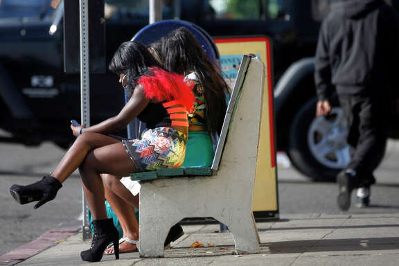 """Young women hang out along International Boulevard in Oakland in an area that is known as  the """"track,""""  a place where they sell themselves, with many exploited as victims of sexual trafficking."""