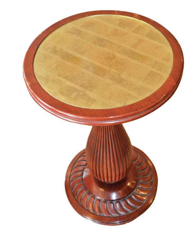 End Table:Stickley, Audi & Co. is home to a large selection of quality furnishings, including a diverse choice of end tables featuring a variety of designs inspired by antiques.  This round wooden table with inlaid gold design ($2,034) is just one of many great choices.
