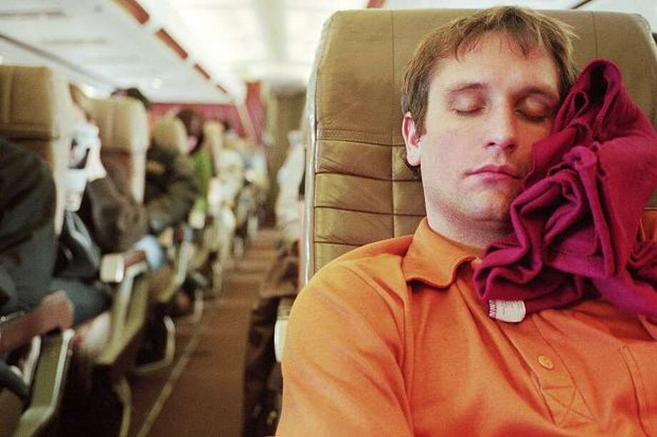 Get as much sleep as you can on the flight, preferably without the use of alcohol. If you need something to kick start the sleepiness, try melatonin. Photo: Stock Photography
