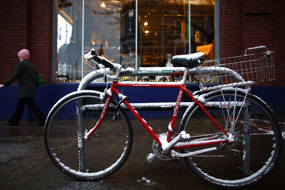 A bike is shown dusted with snow in Seattle's Capitol Hill neighborhood. Photo: JOSHUA TRUJILLO, SEATTLEPI.COM STAFF