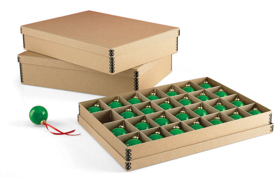Archival storage boxes protect fragile items and anything made with natural fibers. Photo: Courtesy Container Store
