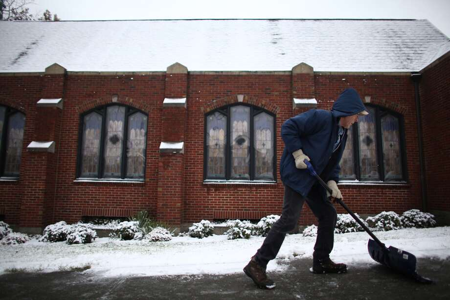 Duane Miles shovels snow in front of Central Lutheran Church on 11th Avenue in Capitol Hill. Photo: JOSHUA TRUJILLO, SEATTLEPI.COM STAFF