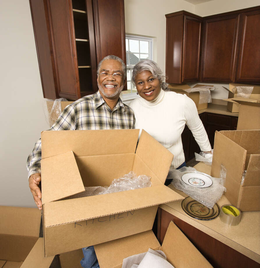 Help minimize moving costs by doing some work yourself and by paring what needs to be moved. Photo: Ron Chapple Stock / Copyright 2009 Ron Chapple Stock