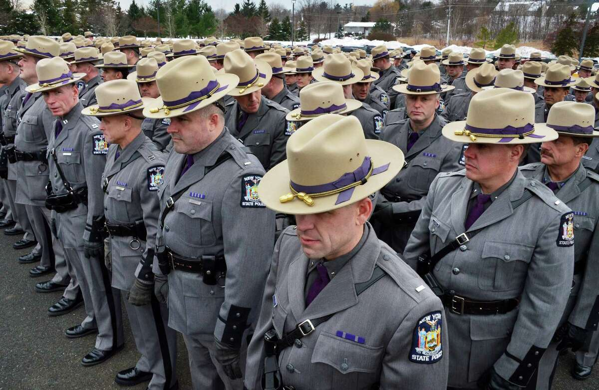NYS Troopers in formation for David W. Cunniff's funeral at Grace Fellowship Church Friday Dec. 20, 2013, in Colonie, NY. (John Carl D'Annibale / Times Union)