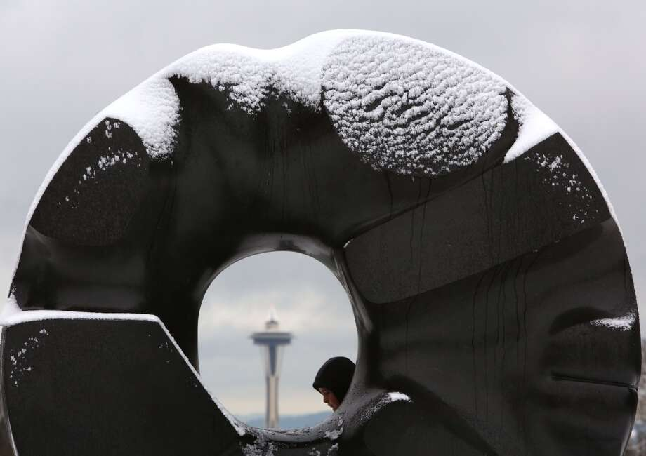 "Snow is shown on Isamu Noguchi's ""Black Sun"" sculpture at Seattle's Volunteer Park after snow fell in Seattle. Photo: JOSHUA TRUJILLO, SEATTLEPI.COM STAFF"